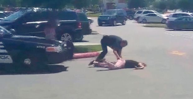 Cop Slams Mom to Pavement, Knocks Her Unconscious in Front of Six-year-old Daughter