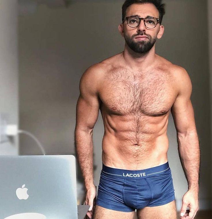 Attractive hairy man in grey underwear smirking