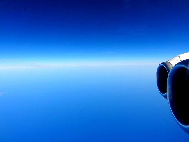 Beyond the deep-blue sky and the light-blue sea