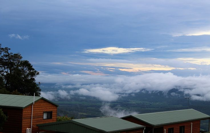Storms in the distance and low cloud in front of the cabins. #cloud #scenery
