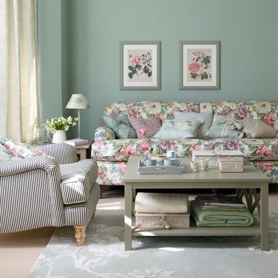 The non-matching furniture works. And I like the colours on the wall and table combined with chintzy fabric and prints.
