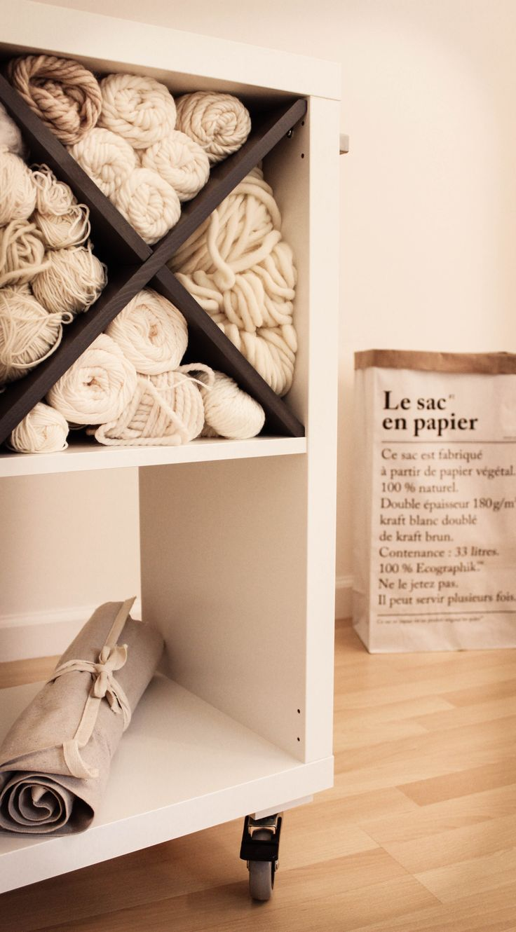 Ikea Hack - Kallax shelving unit fitted with castors, handle and NORNÄS wine rack for yarn storage.