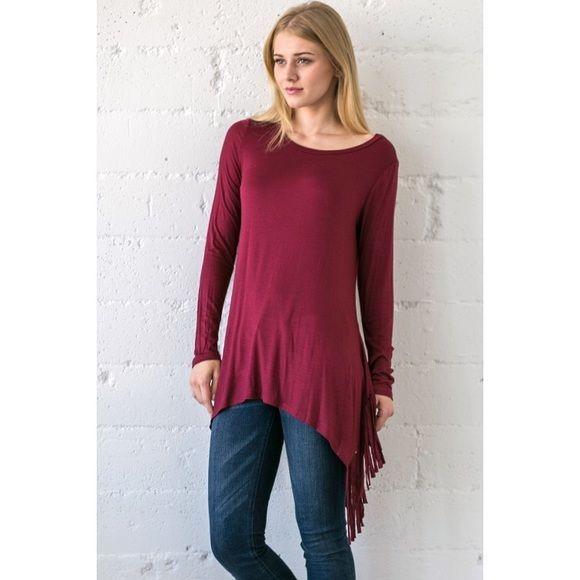Burgundy Fringe Side Tunic Top Size Medium Burgundy fringe side long tunic top, can be worn as a dress or long tunic top!! 95% Rayon 5% Spandex Blend