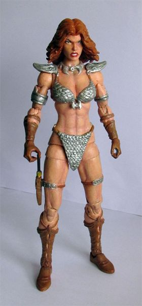 """Here's a custom of Red Sonja, a character we'll probably never see in superarticulated 6"""" form, since Marvel doesn't own the rights anymore.  I've based myself in the art of many artists. I've used a ML Thundra, chopped off the side hair and resculpted it, so that she could turn her head to the sides. I've sculped all the details of the clothes and armor with epoxy and customized her dagger and sh. . ."""