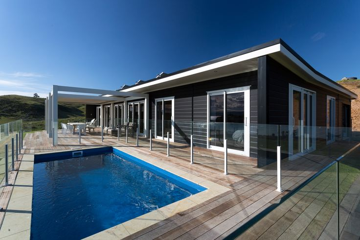 Lockwood Verandah Plan sits proudly on its island site for these lucky clients