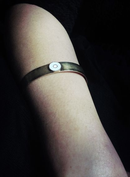 Silver gold-plated bracelet with amulet eye.