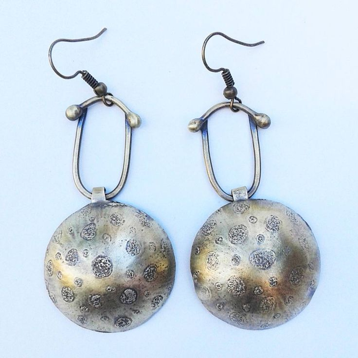 "Etched earrings. They have been ""aged"" for a more dynamic look."