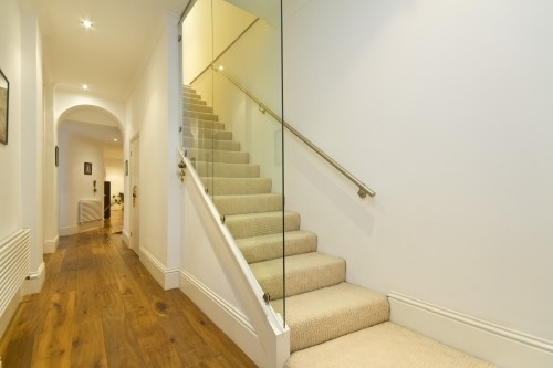 I like the use of the plexiglass wall to create openess in the stairwell and hallway.