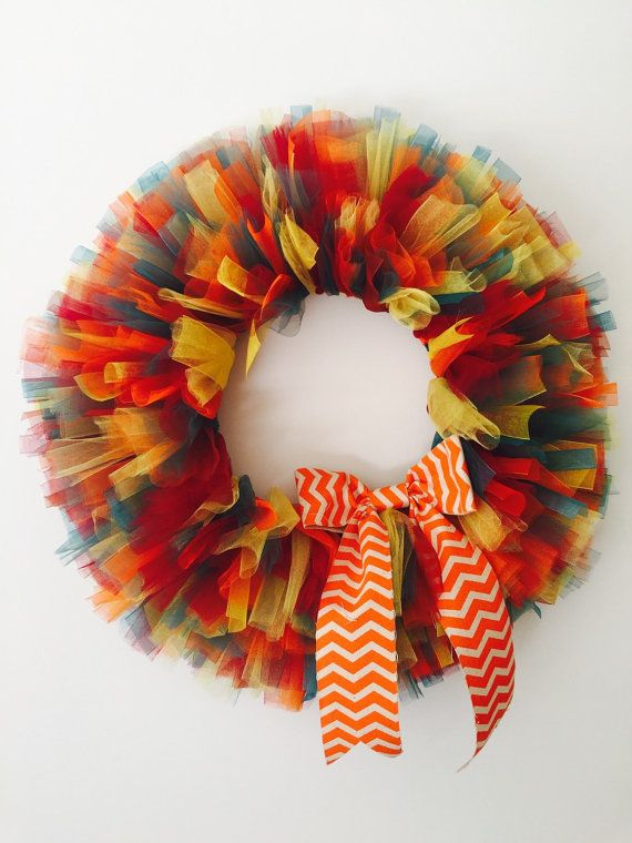 Love these bright fall colors!! This is a handmade wreath made with tulle and some ribbon. This will make anyones fall bright! This wreath is not quite 21 inches wide. Perfect size for any door!! Ready to be shipped