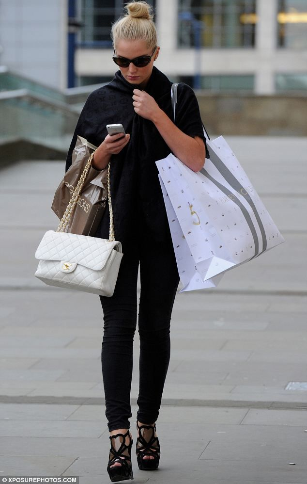 Designer: Not only was Helen carrying a Chanel handbag but she also had a couple of bags from Harvey Nichols