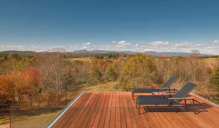 4 Springs Lane : Modern balcony, veranda & terrace by Robert Gurney Architect