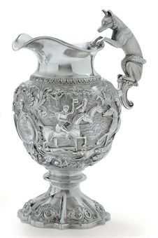 A WILLIAM IV SILVER WINE JUG MARK OF JOHN FRY II, LONDON, 1831 Baluster form, on shaped circular foot with shells, the body cast with a fox hunting scene, centering a cartouche engraved with a coat-of-arms, the handle formed as a fox