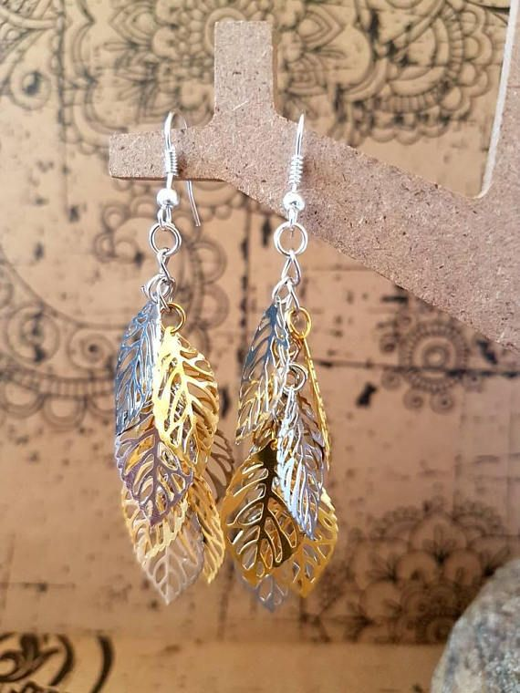 Check out this item in my Etsy shop https://www.etsy.com/au/listing/533550770/silver-and-gold-leaf-cluster-earrings