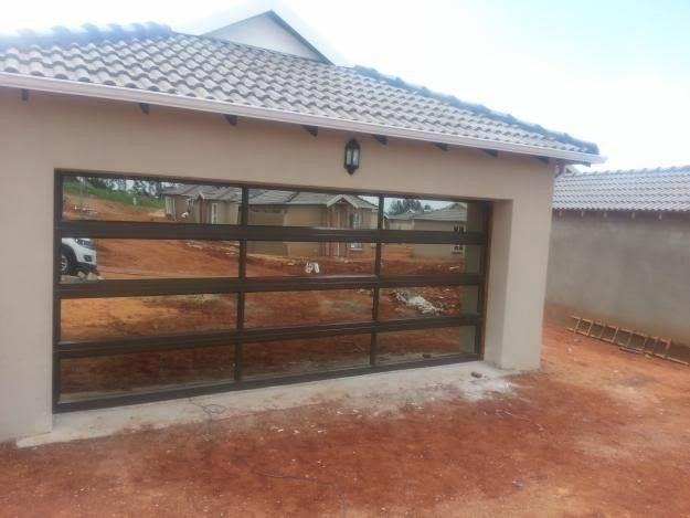 Glass Garage Doors Aluminium Products Bloemfontein 14 Best Doorzone On The Front Covers Images Beautiful O In 2020 Garage Doors Garage Doors Prices Glass Garage Door