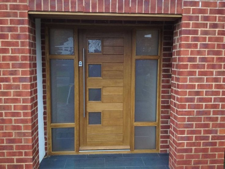 Contemporary front door with double side glass and modern furniture
