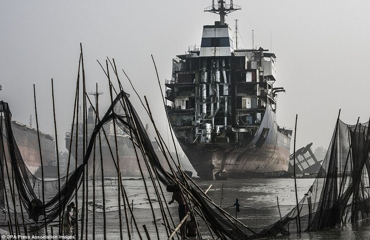Fishermen place their nets at low tide in front of the ship-breaking yards in Chittagong, ... http://dailym.ai/1muZtk9#i-9c810e3f