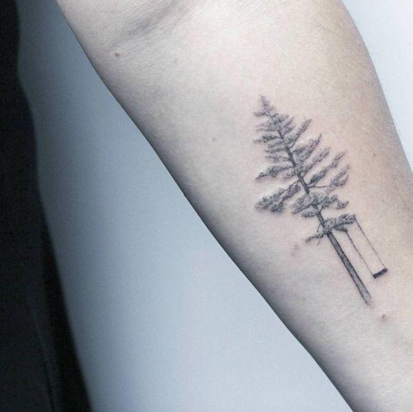 Elegant tree swing tattoo by Lindsay April