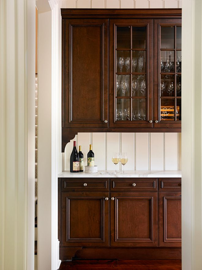pantry with dark stained cabinet and white marble countertop marble countertop