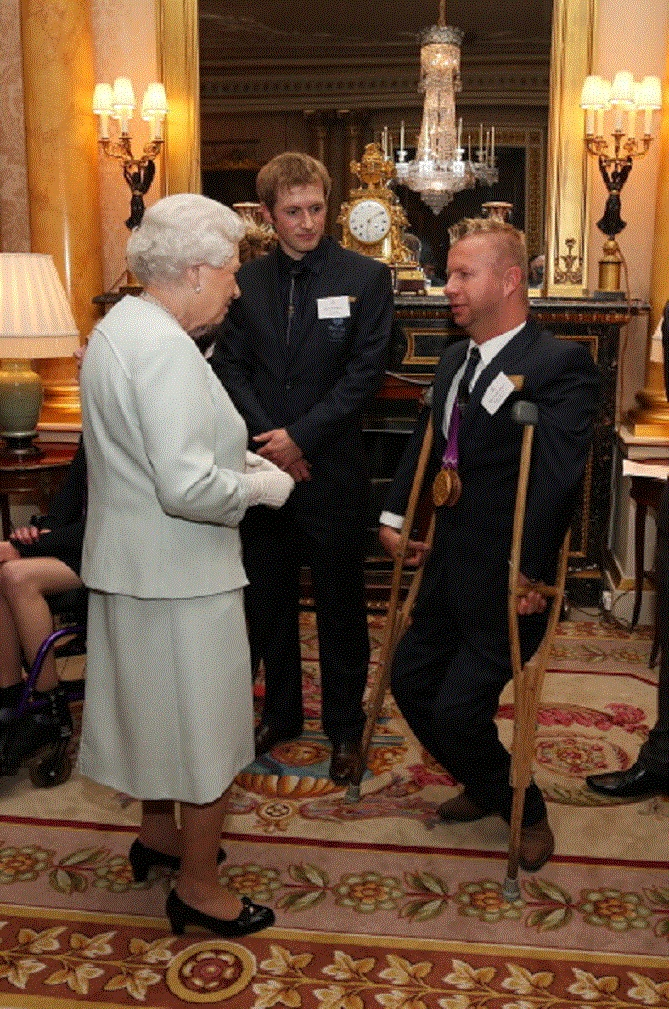 Oct 23 - Queen Elizabeth II meets para-equestrian ridere Lee Pearson during a reception for the Team GB Olympic and Paralympic medalists at Buckingham Palace