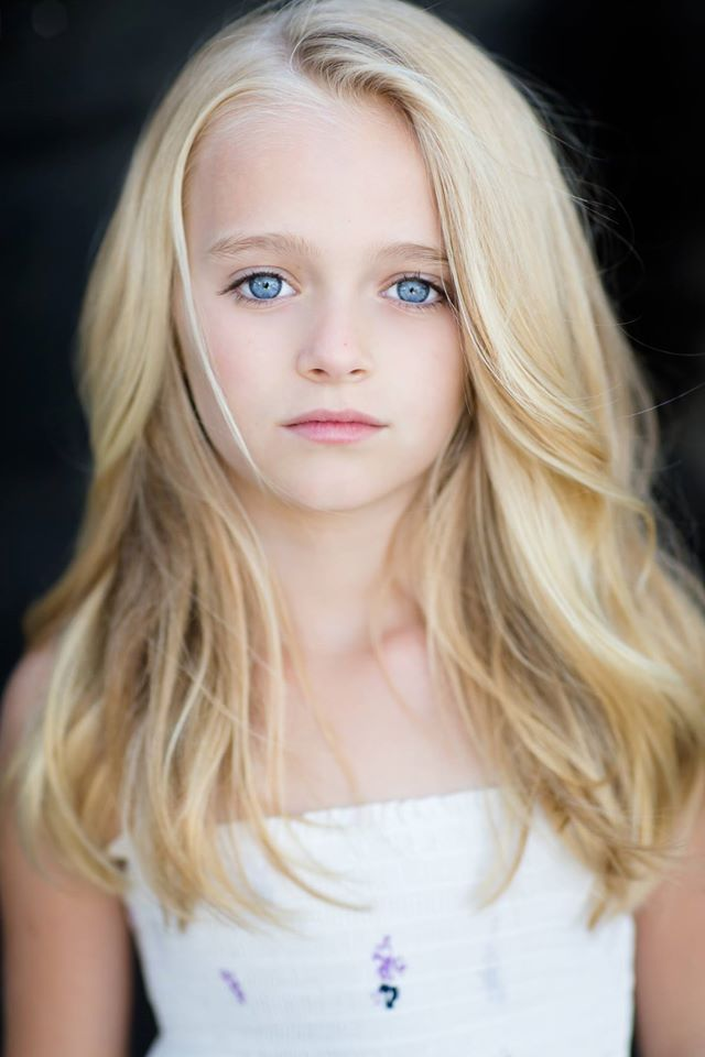 Little girl with blonde hair and icy blue eyes