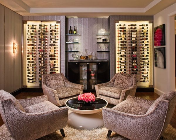 Living room #seating area with built-in #wine wall #display. Looks like an awesome room to relax and catch up with friends.