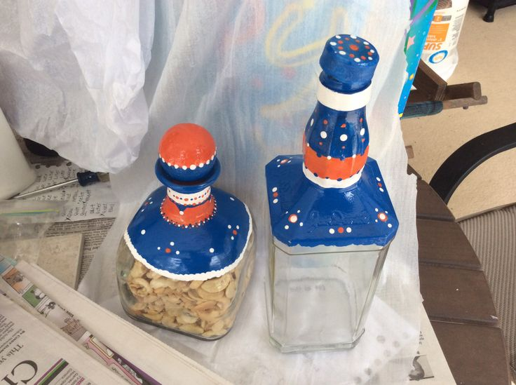 Florida Gators decorated liquor bottles.  Fill with nuts.