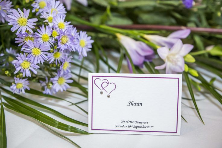 Purple boarder with two purple hearts and little crystals - name tags.