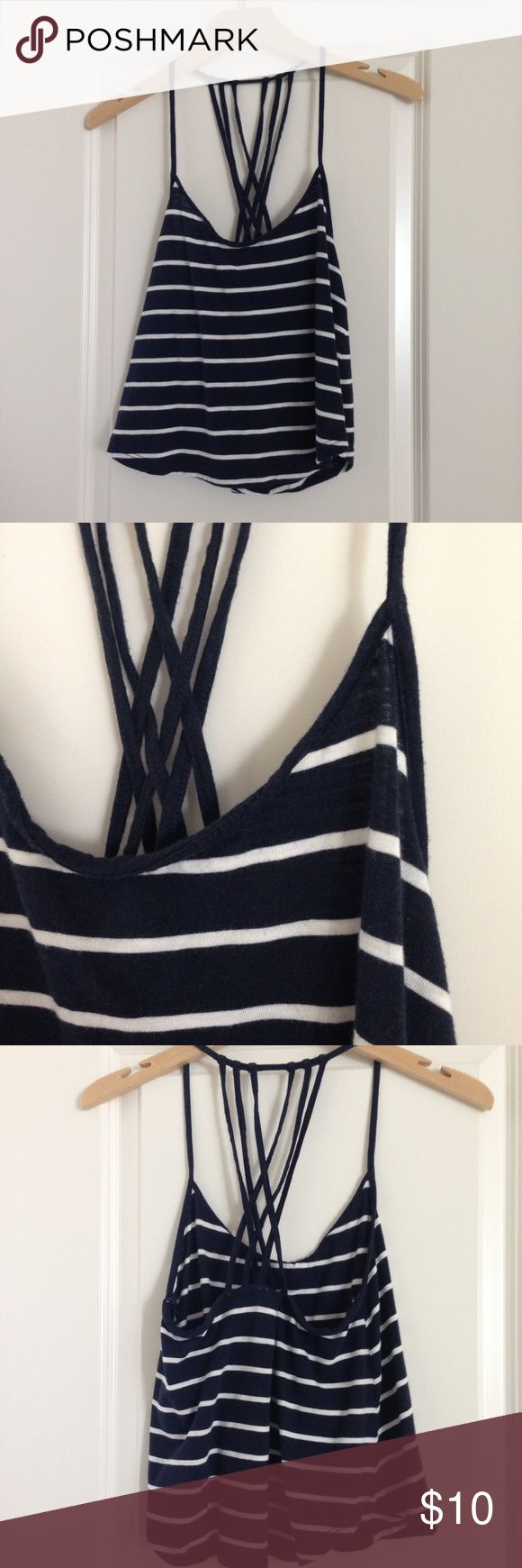 """navy striped strappy cross back tank top size s. good condition. navy and white stripes. worn twice and washed, so it doesnt look """"off the rack"""" new. no flaws, pilling, stains, or rips. fabric has the lived in look. cami style. criss cross straps in back. looks really cute with a bralette! Forever 21 Tops Tank Tops"""
