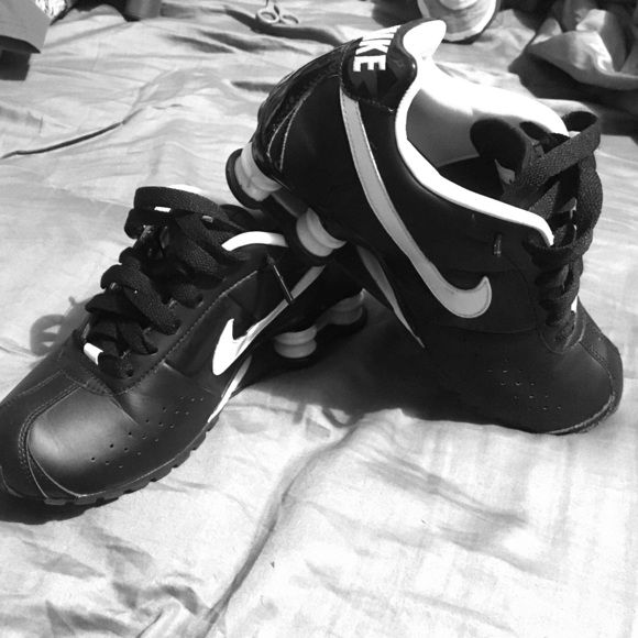 Black and white Nike Shocks New black and white nike shocks. Never worn before. Workout in style with these sleek sneaks!! Nike Shoes Athletic Shoes