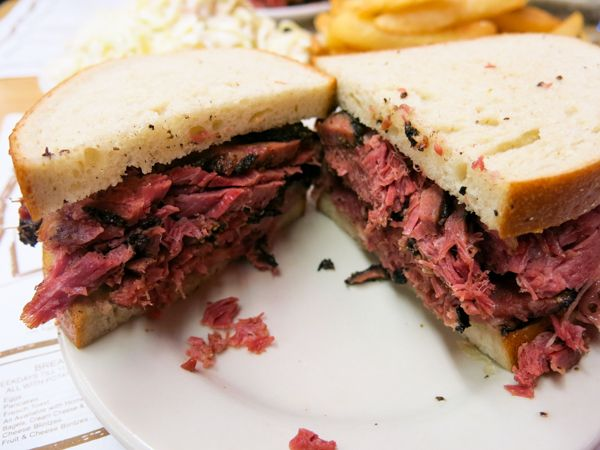 Katz's Deli NYC. Get a pastrami on white (share with a friend, trust me), fries, fresh pickles, and a chocolate egg cream. Can't beat it!