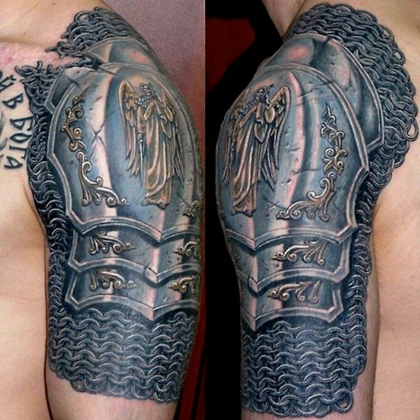 """"""" Stunning.  I love the way the scar plays in too. """" Awesome chainmail and armor tattoo."""