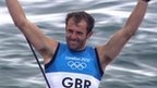 Great Britain's Nick Dempsey secures silver in the men's RS:X windsurfing class as Dorian van Rijsselberghe of the Netherlands wins gold in Weymouth on Tuesday.