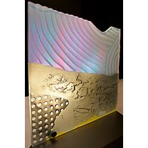 """Warren Carther, Eugene, 2013. Carved glass sculpture with applied colours and Dichroic filter. 27"""" x 27"""". Valued at $5,000"""