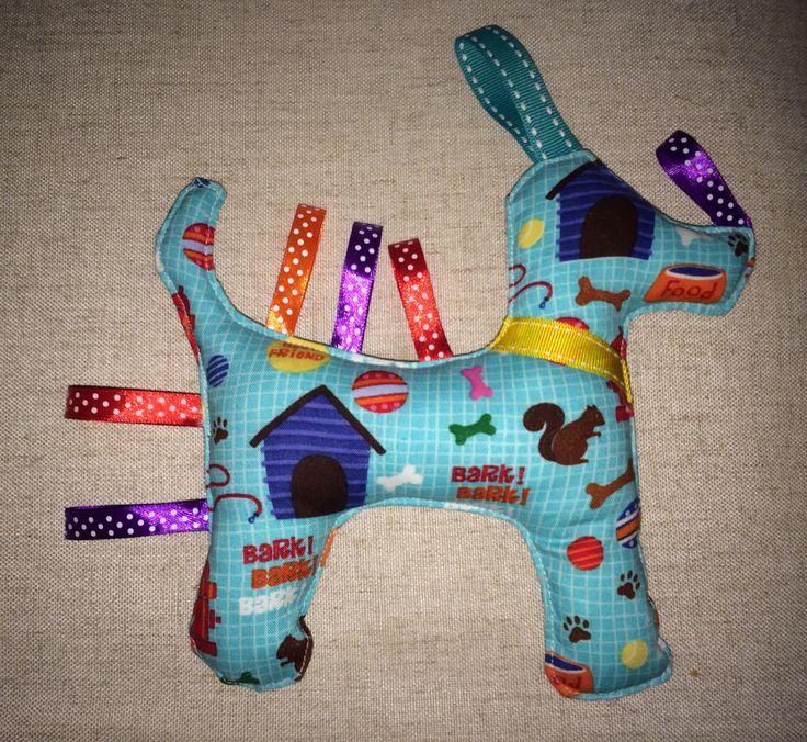 Stuffed sensory toy. Baby taglet.