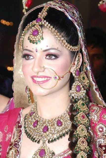 Pakistan Bride - Pink and Purple  Disclosure: I didn't do the makeup for this model..This was taken from a Google (Images)  website that is open for public viewing.