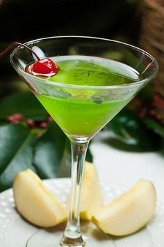"""Green Appletinis"" Ingredients: 4 ounces Vodka 2 ounces Sour Apple Pucker 2 ounces Midori or Melon liqueur Maraschino cherries"