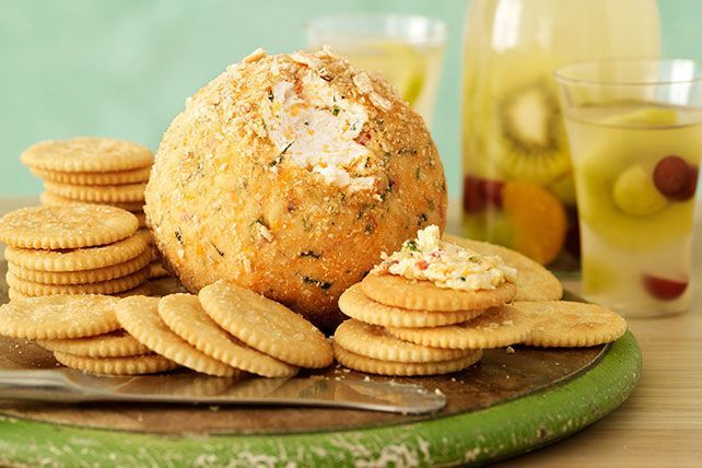 Give your cheese ball a kick of flavor. Fresh cilantro and lime plus pepper Jack cheese and chili powder spice things up.