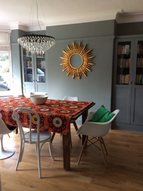 Dining room in Plummett by Farrow and Ball. The kantha quilt makes an interesting table runner. The sunburst mirror and 1930's style chandelier adds some glamour.