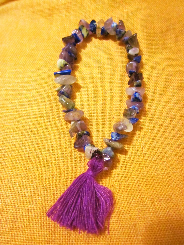 A very beautfiful finger mala to hold it every where in order to stay foocus and under meditation where ever you are. It is made with 27 sodalites and 27 amethysts.Sodalite brings inner peace and amethyst guards against psychic attack, transmuting the energy into love and protecting the wearer from all types of harm, including geopathic or electromagnetic stress and ill wishes from others. Just hold it with your fingers and counting the stones repeat your favourite affirmation.