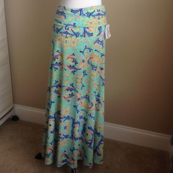 Lularoe Maxi Skirt Sun Dress Mint damask print NWT Mint skirt with damask print, coral, periwinkle, pink, and navy accents, high low. Can be used as swim cover, maxi skirt or maxi dress. LuLaRoe Dresses Maxi