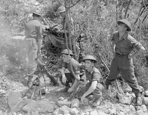 ROYAL AIR FORCE ITALY BALKANS SOUTH-EAST EUROPE 1944-1945 (CNA 2866) A 3-inch mortar crew of No. 2771 Field Squadron RAF Regiment bombarding enemy positions from their position in a ravine on the Colle Belvedere, north of Cassino, Italy.
