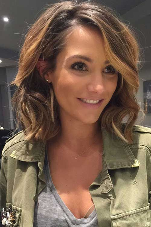 Wavy highlighted brunette long bob with sideswept bangs