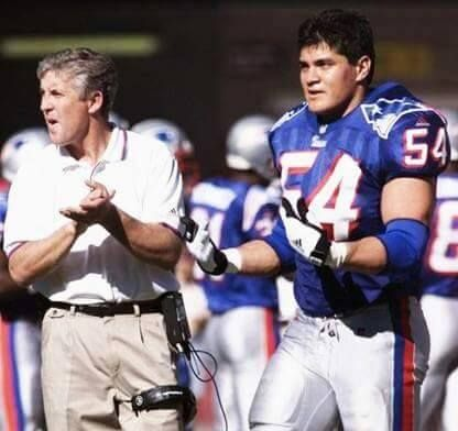 Patriots throwback, Ted Bruschi and then Patriots head coach Pete Carroll.