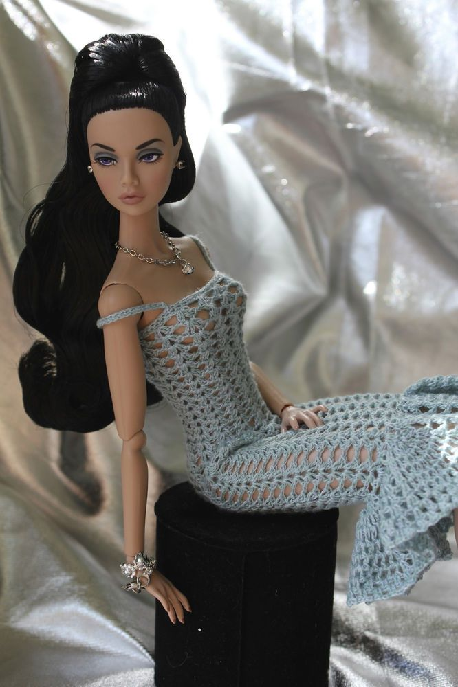 Aquamarine Dress for Poppy Parker or NU face Doll - A little too open for my taste, but I could close in the areas that reveal the private parts. Okay I know its for a doll but even they deserve some modesty!