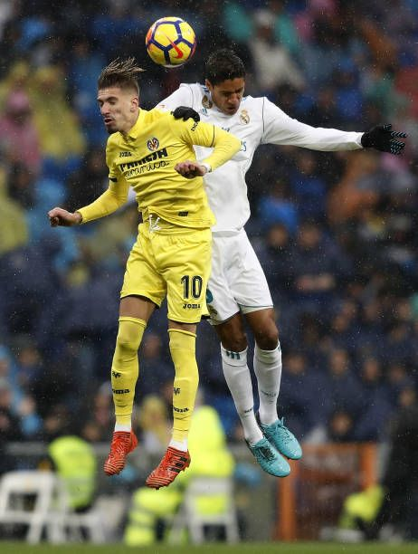 Raphael Varane of Real Madrid competes for the ball with Samu Castillejo of Villarreal during the La Liga match between Real Madrid and Villarreal at...
