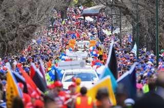Australian sports stars urged to boycott anthem in AFL and NRL finals