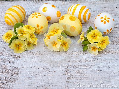 Easter eggs and primrose flowers bouquets composition