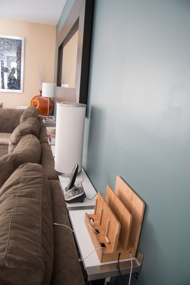 If your living room is on the small side, don't fill it up with a clunky coffee table. Instead, build a thin behind-the-sofa table using IKEA shelves! This DIY project will save you a TON of space
