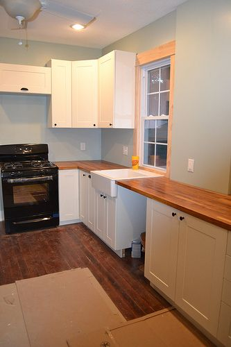 IKEA cabinets: $2,600 for the entire kitchen, including the countertops. For a cost comparison sake, that's $6,500 at Lowe's for the baseline white cabinets. (Lower than $9,500 at the local shop.) That's just cabinets alone – no countertops, sink, etc.