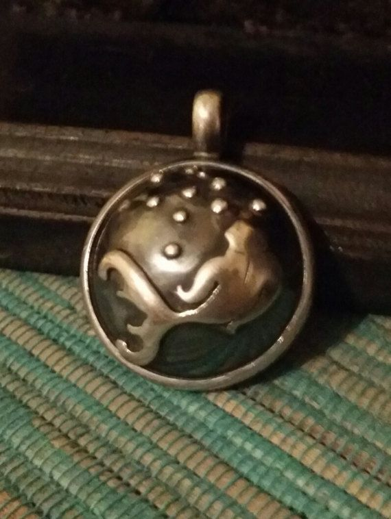 Check out this item in my Etsy shop https://www.etsy.com/uk/listing/497794780/sterling-silver-fish-pendant-bubbles